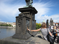 charles bridge touching plaque