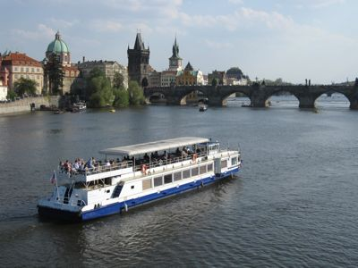 Prague river boat and Charles Bridge