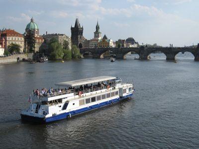 Prague river boat and Charles Bridge