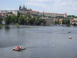 Paddle boats on river in Prague